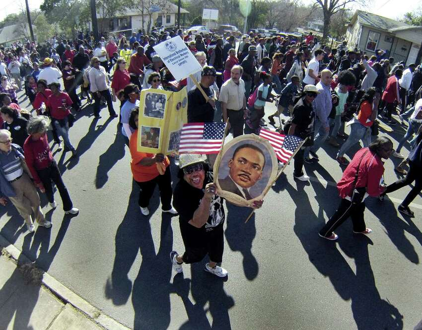 Marchers make their way down Martin Luther King Drive during the signature event organized by the city's Martin Luther King Jr. Commission. The march drew an estimated 175,000 people.