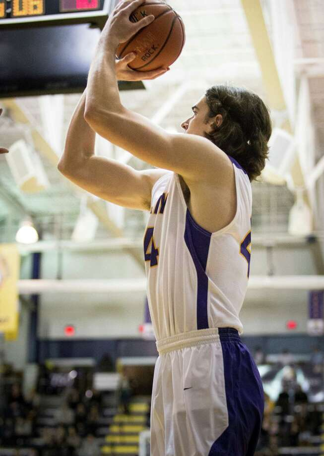 UAlbany's #44 John Puk puts up a jumper during the men's basketball game against Binghampton at SEFCU Arena, Monday, Jan. 20, 2014 in Albany, N.Y. (Dan Little / special to the Times Union) Photo: Dan Little / Dan Little/ Times Union