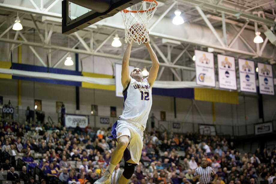 UAlbany's #12 Peter Hooley goes in for a breakaway dunk during the mens' basketball game against Binghampton at SEFCU Arena, Monday, Jan. 20, 2014 in Albany, N.Y. (Dan Little / special to the Times Union) Photo: Dan Little / Dan Little/ Times Union