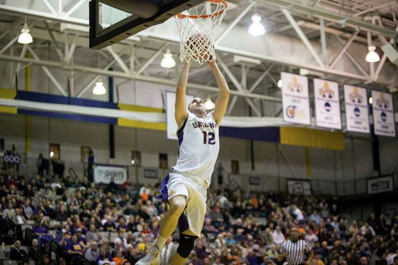 UAlbany's #12 Peter Hooley goes in for a breakaway dunk during the mens' basketball game against Bin