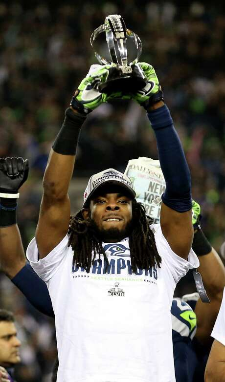 Seattle's Richard Sherman celebrates with the George Halas Trophy after the Seahawks beat the 49ers 23-17 in the NFC championship. Photo: Christian Petersen / Getty Images / 2014 Getty Images