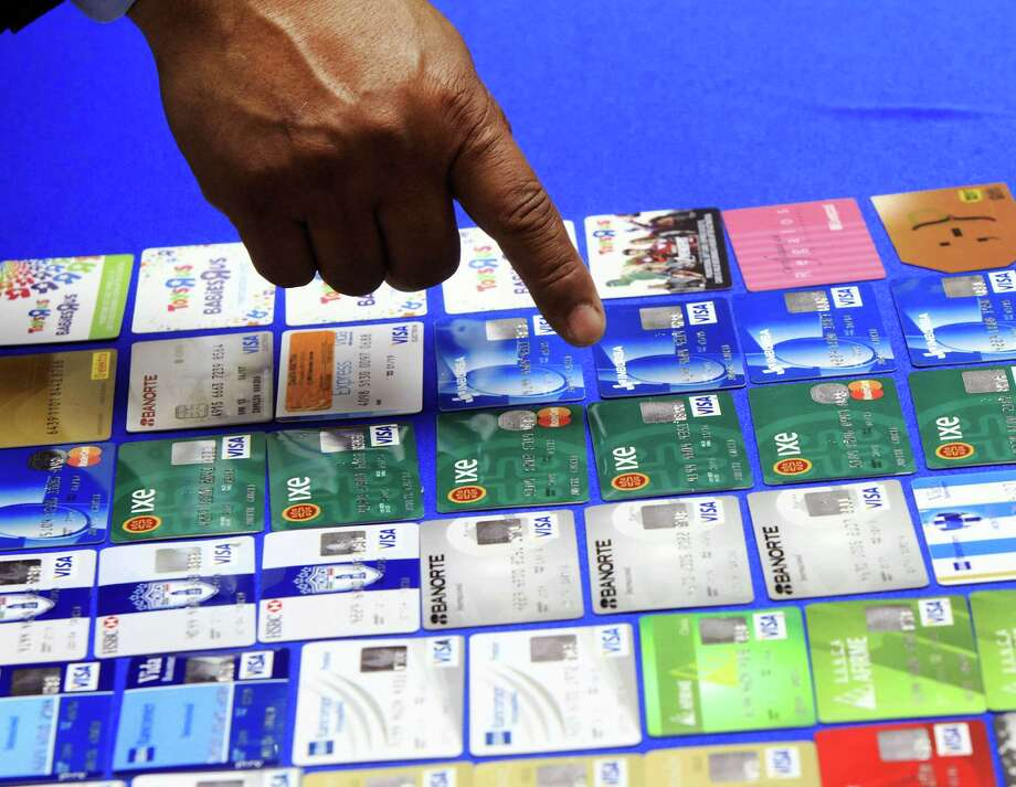 Police Chief Victor Rodriguez shows fake credit cards confiscated by McAllen police after a couple from Mexico were arrested. Photo: Gabe Hernandez / (McAllen) Monitor / The Monitor