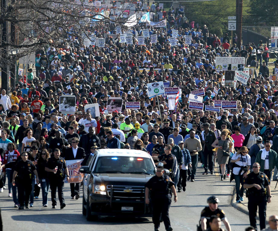 Marchers head for Pittman-Sullivan Park Monday January 20, 2014 at the start of the Martin Luther King march in San Antonio. Photo: JOHN DAVENPORT, SAN ANTONIO EXPRESS-NEWS / ©San Antonio Express-News/Photo may be sold to the public