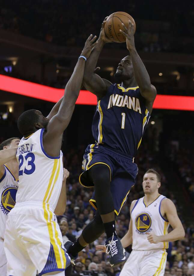 Indiana's Lance Stephenson shoots over the Warriors' Draymond Green in the first half. Photo: Ben Margot, Associated Press