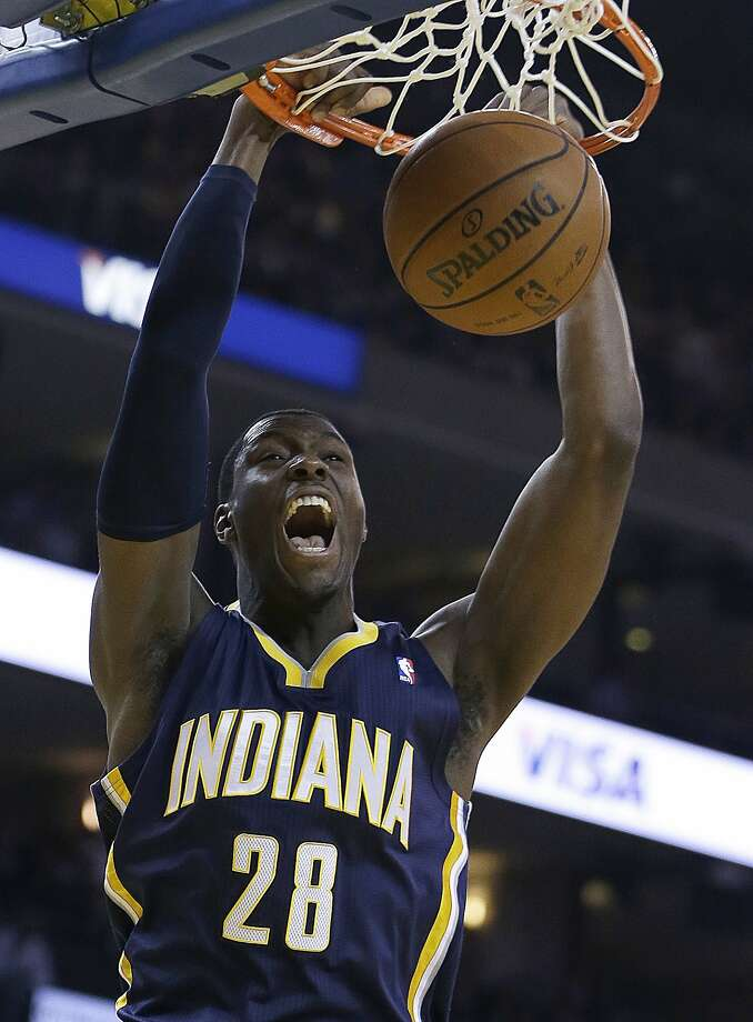 Indiana Pacers' Ian Mahinmi scores against the Golden State Warriors during the first half of an NBA basketball game, Monday, Jan. 20, 2014, in Oakland, Calif. (AP Photo/Ben Margot) Photo: Ben Margot, Associated Press
