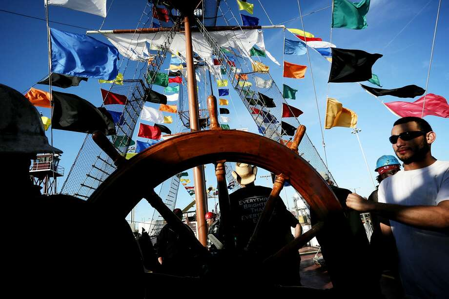 In this Jan. 17, 2014 photo, the steering wheel is brought aboard the Jose Gasparilla in the Port of Tampa in Tampa, Fla. The ship, used by Ye Mystic Krewe, of Gasparilla, to ceremonially invade the City of Tampa, is actually a barge whose direction is controlled by a pair of tugboats. (AP Photo/The Tampa Bay Times, Edmund D. Fountain) Photo: Edmund D. Fountain, Associated Press