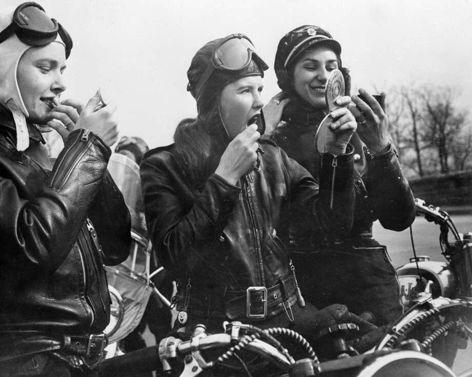 Bikers Marian Willgoes, Joan Nimlo and Gloria Crane reapply their make up during a meeting of their all female motorbike club in Queens, New York, 1950. Photo: Keystone Features, Getty Images