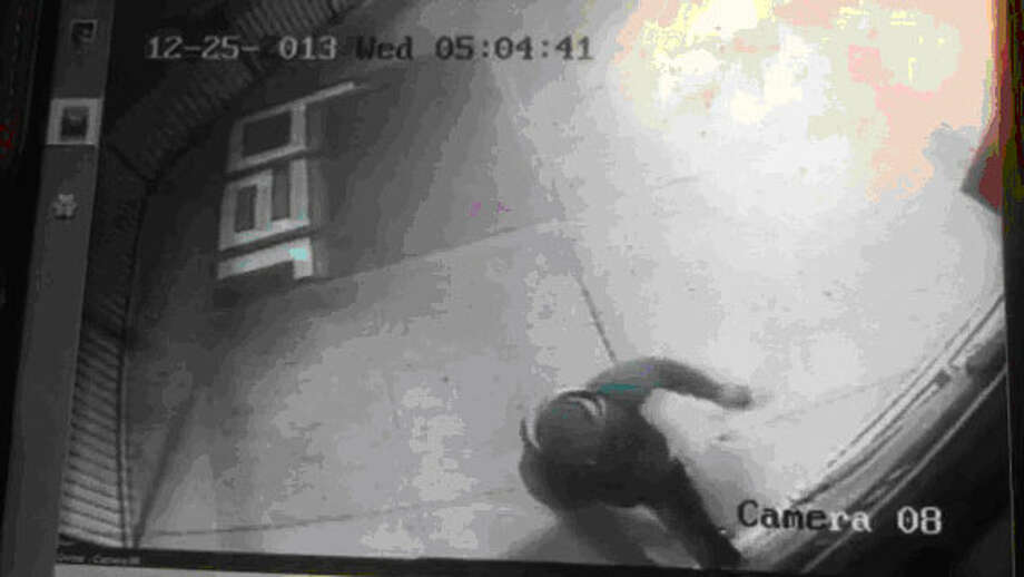 San Antonio Police and San Antonio Crime Stoppers are requesting the public's assistance indentifying the male suspect who burglarized the Red Square Bar on Dec. 25, 2013. Photo: Courtesy