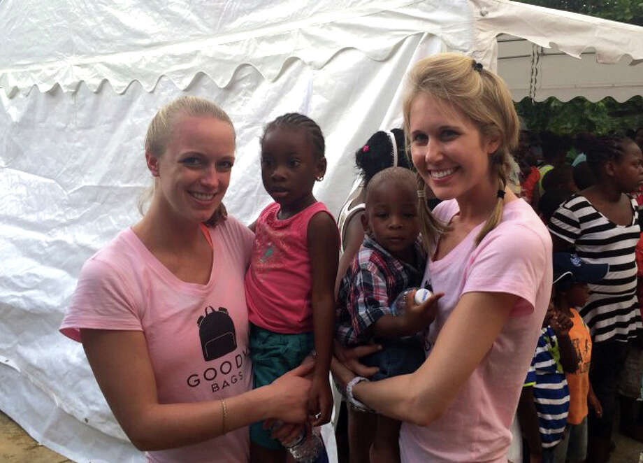 Morgan Jacobs, at left, and Rena Stein came together to create GoodyBags, a non-profit organization. They went to Jamaica during Christmas to distribute their bags to impoverished children. Photo: Contributed Photo, Contributed / Darien News Contributed