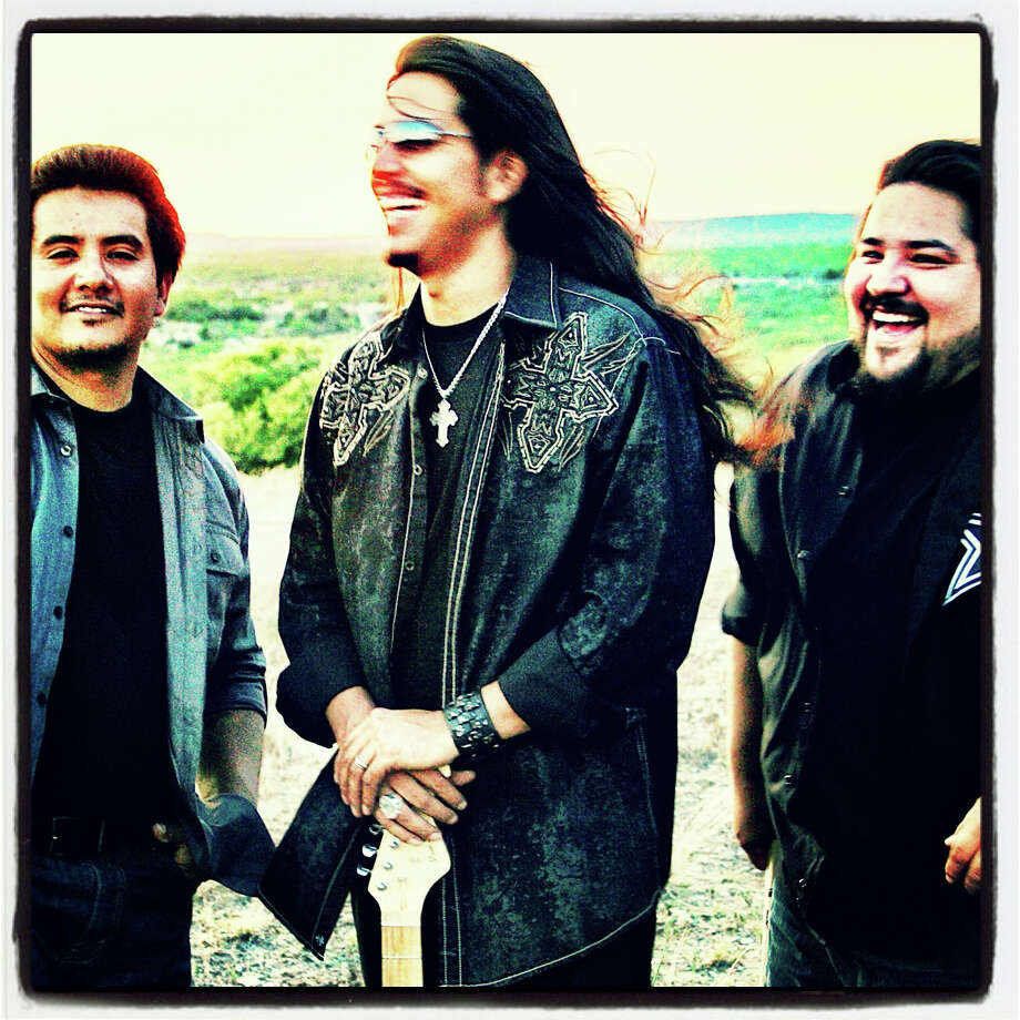 "Los Lonely Boys, American rock power trio from San Angelo, Texas. They play a style of music they call ""Texican Rock n' Roll,"" combining elements of rock and roll, Texas blues, brown eyed soul, country, and Tejano. Photo: Conqueroo Publicity"