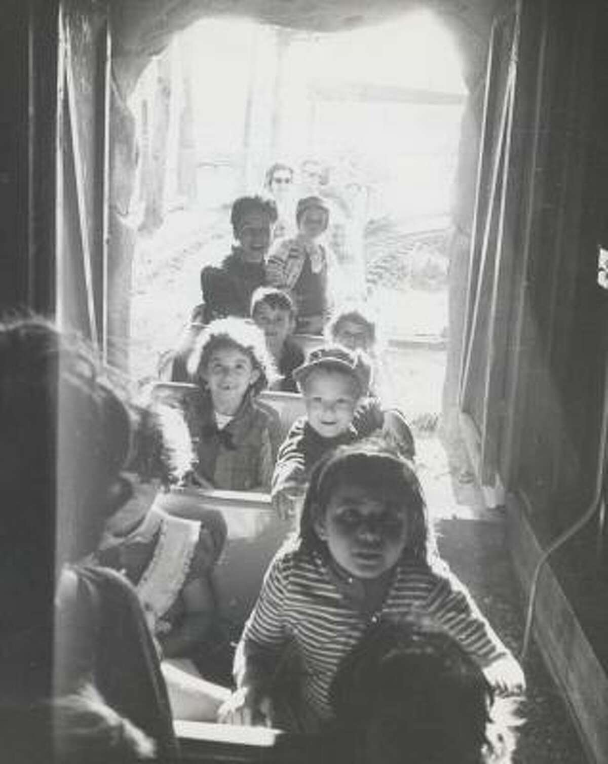 Children enter the tunnel while taking a ride on the Hermann Park train in 1968.