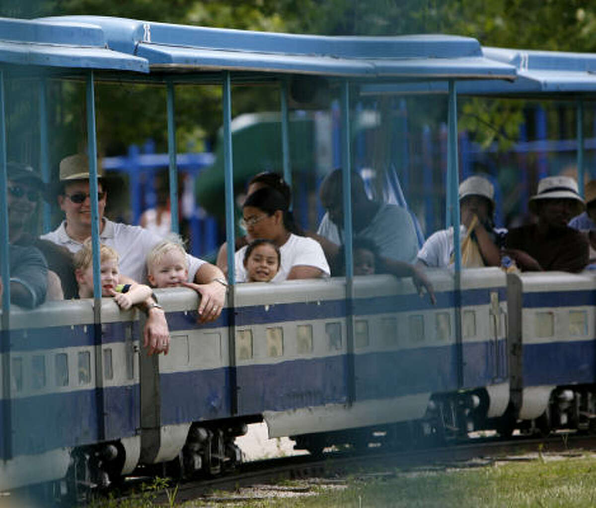 Drew Keady, 4, left, and his cousin, Carter Jones, 2, right, ride the train on Saturday.