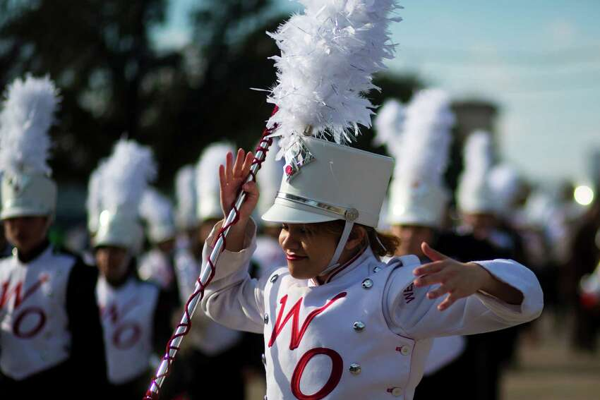 The West Oso High School Mighty Machine Bear Band drum major leads the band down San Jacinto Street during the 20th Annual MLK Grande Parade, Monday, Jan. 20, 2014, in Houston.