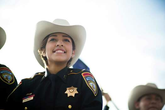 A Harris County Sheriff's Office Explorer Program member takes a look at the audience from their float  during the 20th Annual MLK Grande Parade, Monday, Jan. 20, 2014, in Houston. Photo: Marie D. De Jesus, Houston Chronicle / © 2014 Houston Chronicle