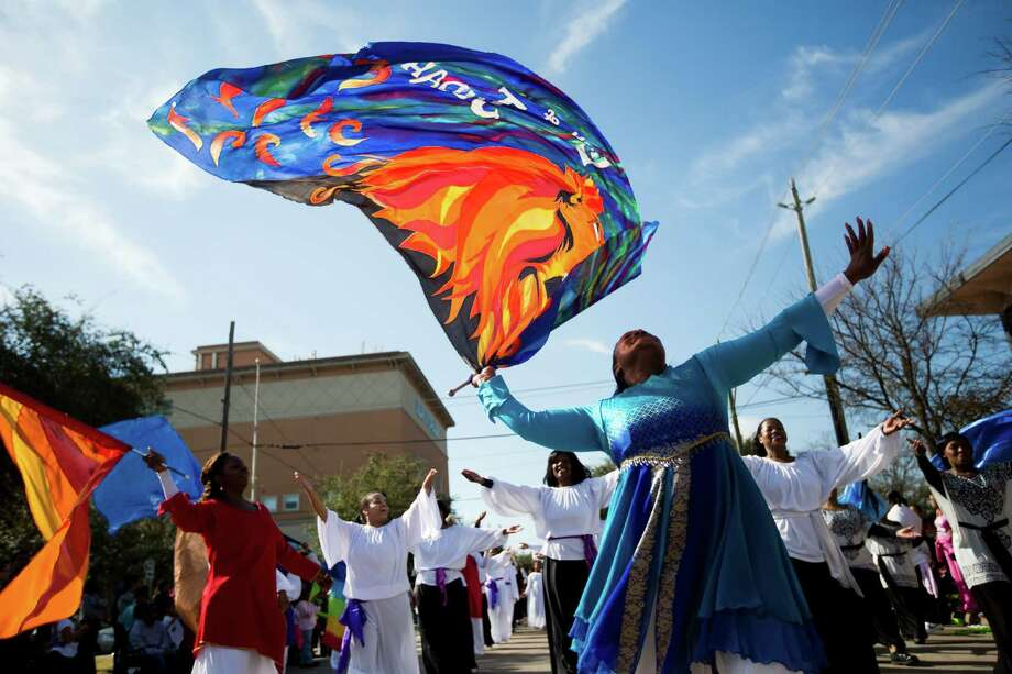 Faith based group pay tribute to the legacy of Dr. Martin Luther King Jr. performing for the audiences enjoying the 20th Annual MLK Grande Parade, Monday, Jan. 20, 2014, in Houston. Photo: Marie D. De Jesus, Houston Chronicle / © 2014 Houston Chronicle