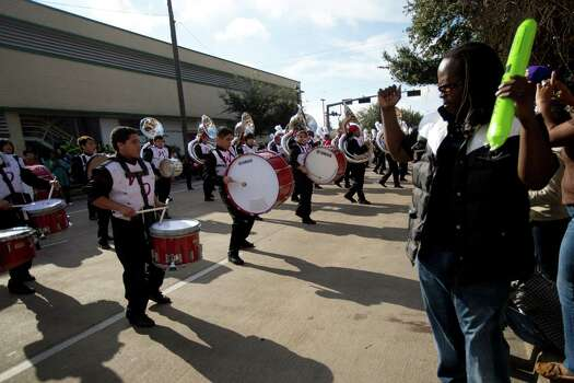 William Colvin, right, dances to the music of the West Oso High School Mighty Machine Bear Band, Monday, Jan. 20, 2014, in Houston during the 20th Annual MLK Grande Parade. Photo: Marie D. De Jesus, Houston Chronicle / © 2014 Houston Chronicle