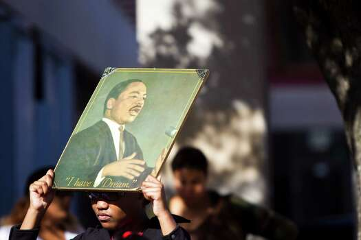 Marilyn Irving, 12, holds a portrait of Dr. Martin Luther King Jr. in remembrance of his legacy at the 20th Annual MLK Grande Parade, Monday, Jan. 20, 2014, in Houston. Photo: Marie D. De Jesus, Houston Chronicle / © 2014 Houston Chronicle