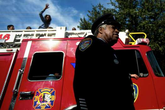 The Houston Fire Department made their present felt parading their fire trucks at the 20th Annual MLK Grande Parade, Monday, Jan. 20, 2014, in Houston. Photo: Marie D. De Jesus, Houston Chronicle / © 2014 Houston Chronicle