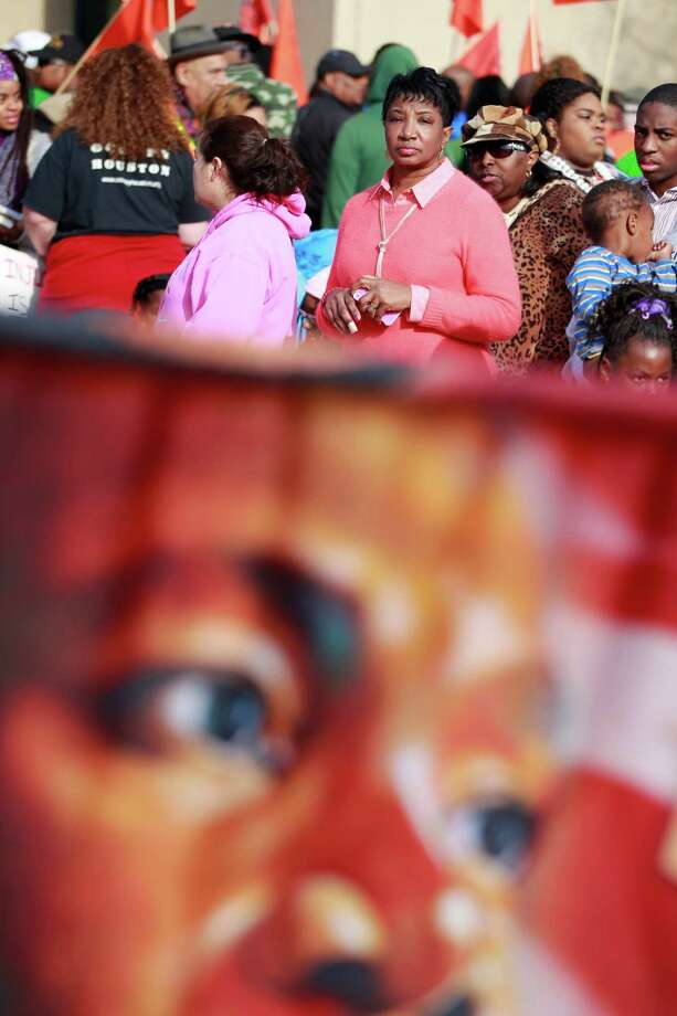 Karen Alexander of Houston watches parade organizers setting up before the 36th annual Dr. Martin Luther King, Jr. Birthday Parade begins at 10:00 am at Minute Maid Park, in Houston, Tx. Photo: Johnny Hanson/Houston Chronicle