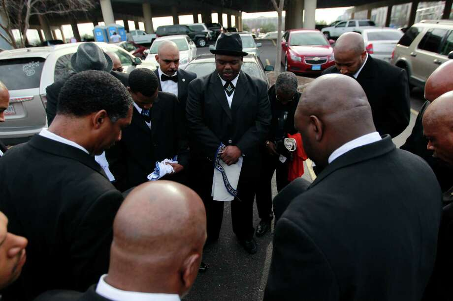 "The ""Original"" 36th annual Dr. Martin Luther King, Jr. Birthday Parade begins at 10:00 am at Minute Maid Park, in Houston, Tx. Group of Prince Hall Masons pray before the MLK parade starts. Photo: Johnny Hanson/Houston Chronicle"