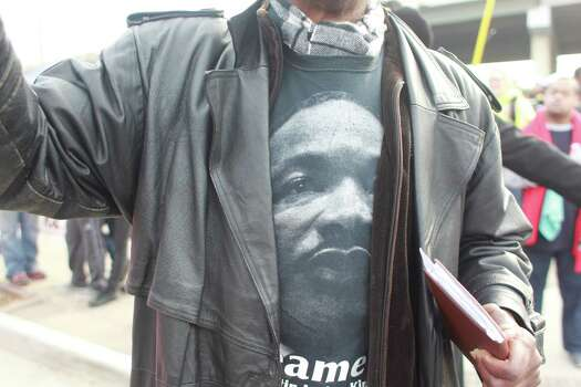 "The ""Original"" 36th annual Dr. Martin Luther King, Jr. Birthday Parade begins at 10:00 am at Minute Maid Park in Houston, Tx. Float organizer Tom Jones wears a MLK t-shirt as he walks the parade route. Photo: Johnny Hanson/Houston Chronicle"
