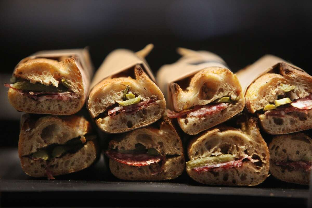 Sandwiches with saucissons sec, black mustard, pickles and almond are seen for sale at Craftsman and Wolves.