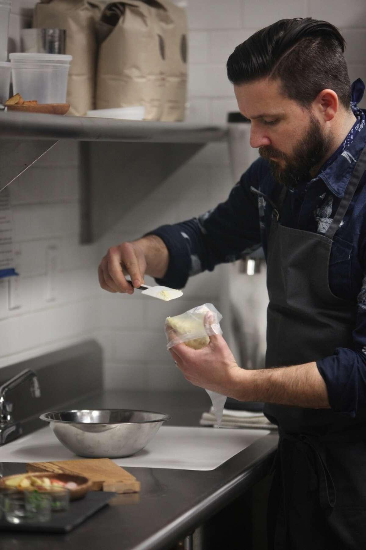 William Werner, owner/partner Craftsman and Wolves prepares salt cod rillettes.