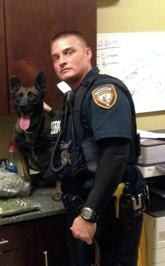 Deputy Jason Denham and his canine partner Sjors. (HCSO photo)