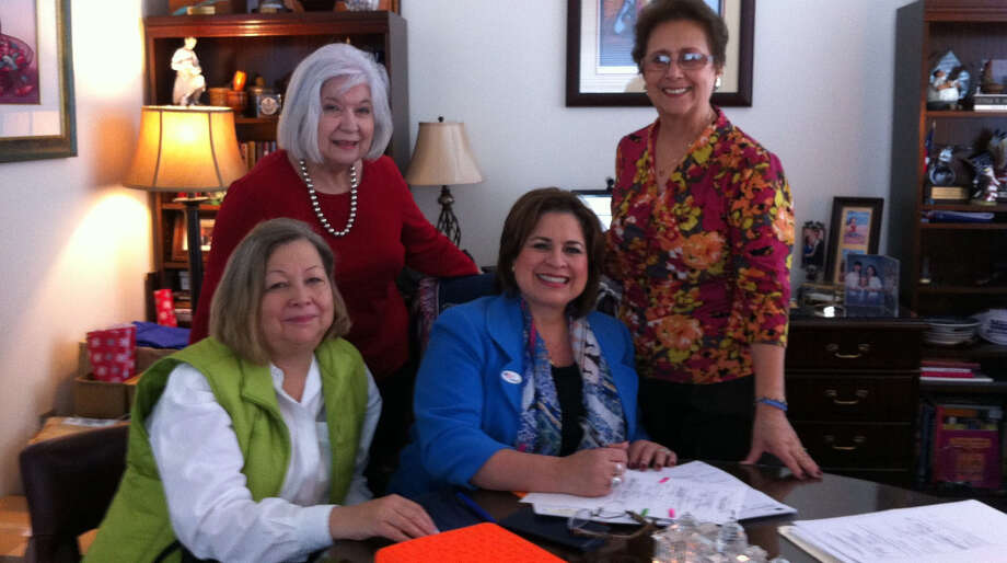 State Sen. Leticia Van de Putte (third from left) signs paperwork to join the DRT on Oct. 30. Photo: Special To The Express-News, Courtesy Photo / Courtesy of DRT Alamo Couriers