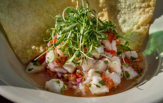 "Ceviche (seh-VEE-chay): A Latin American dish of raw fish that's ""cooked"" or marinated in citrus juice, usually lime. Audio: Click here to hear the term ""Ceviche."" Photo: John Storey, Special To The Chronicle"