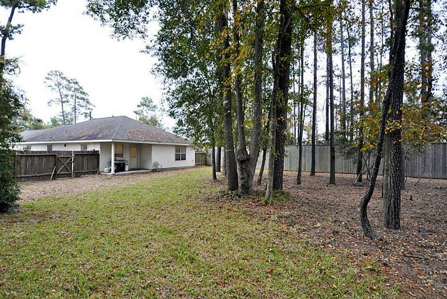 3 Thicket Grove: This 2004 home has 3 bedrooms, 2 bathrooms, 1,605 square feet, and is located in The Woodlands. Listed for $150,000. Photo: Houston Association Of Realtors