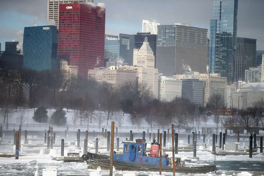 Lake-effect snow: Great Lakes cities like Chicago get more snow than their inland neighbors when a cold wind passes over the warmer lake, picking up water vapor that freezes on the leeward shore. To cheer up people depressed by the weather, Chicago offers a beer called Lake Effect. Photo: Scott Olson, Getty Images