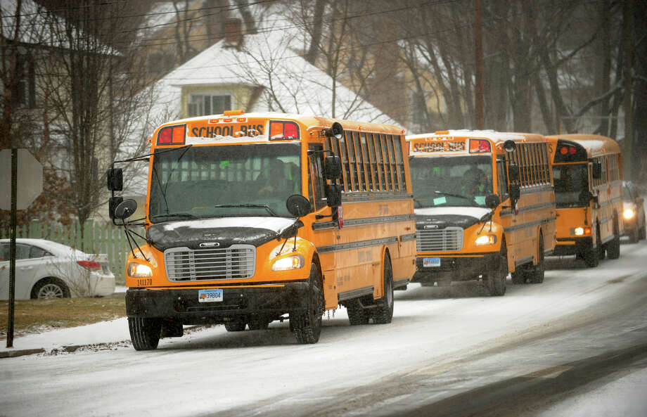 School buses make their way through the snowstorm on Unquowa Road in Fairfield, Conn. on Tuesday, January 21, 2014. Photo: Brian A. Pounds / Connecticut Post