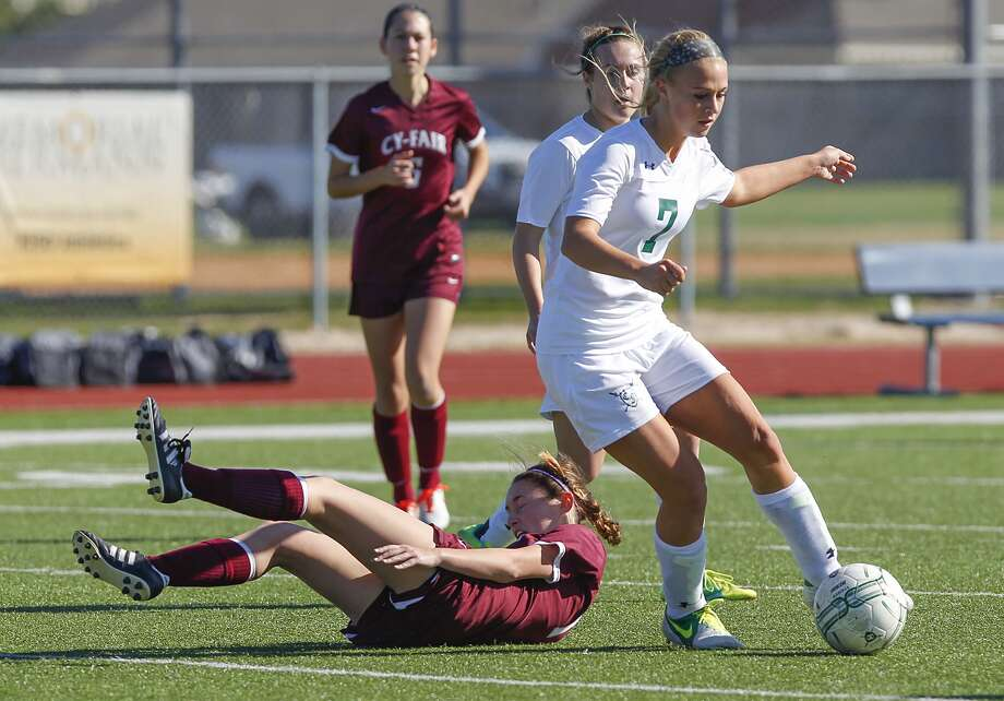 Chelsea Trainor of Clear Falls moved around Gia Gentilini of Cy-Fair as the two teams faced off at the I-10 Shootout Soccer Tournament at Seven Lakes High School in Katy. Photo: Diana L. Porter, Freelance / © Diana L. Porter