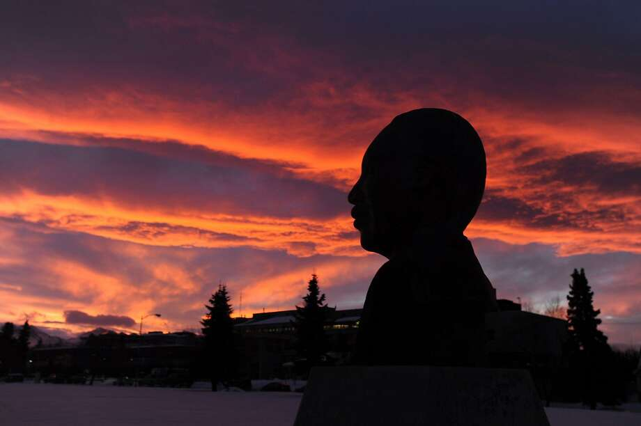 A striking sunrise greets the bust of Dr. Martin Luther King Jr. at his memorial in Anchorage, Alaska. Photo: Erik Hill, McClatchy-Tribune News Service