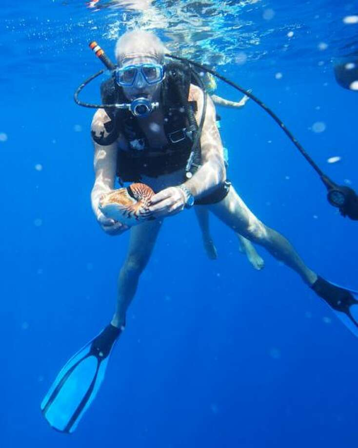 The global ocean will continue to warm during the 21st century. Heat will penetrate from the surface to the deep ocean and affect ocean circulation, from the The Intergovernmental Panel on Climate Change.  Photo: UW paleontologist Peter Ward holds a chambered nautilus in the Pacific Ocean off the shores of American Samoa. Photo went with this story: UW's Peter Ward discovers possible new species of Nautilus (and trouble)