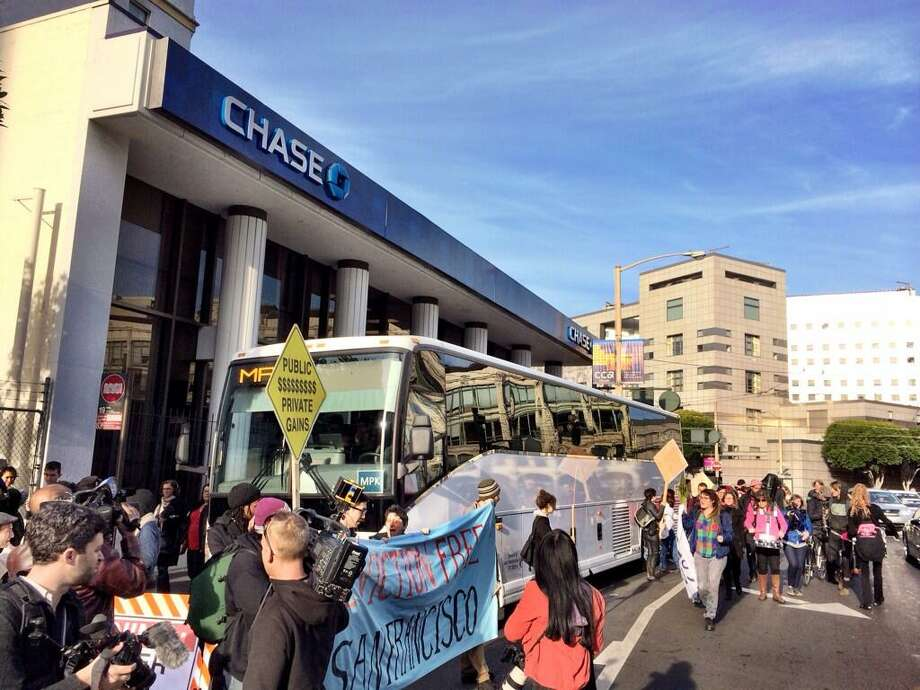 Protesters block a tech bus at Market and 8th streets in S.F. on Jan. 21, 2014. Photo: Kurtis Alexander, The Chronicle