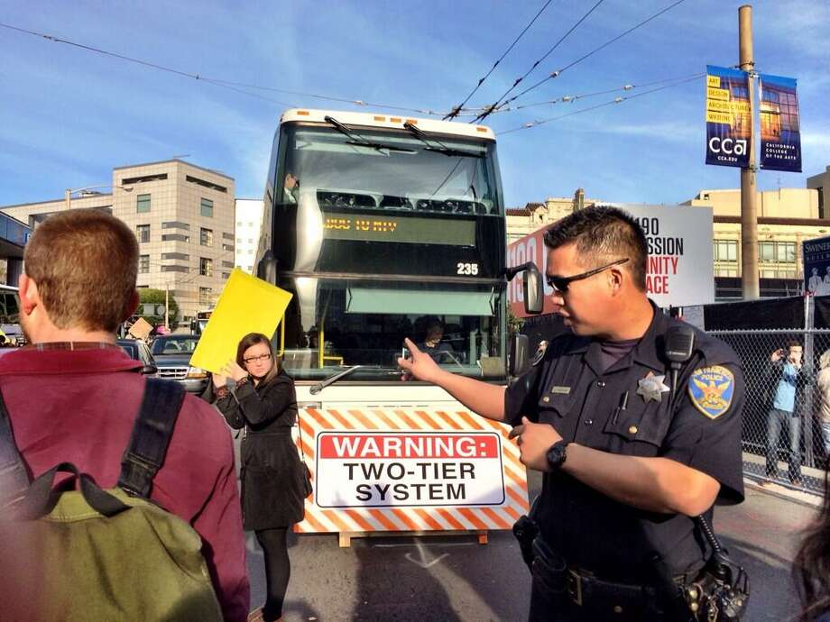 Police try to clear protesters blocking tech buses in downtown S.F. on Jan. 21, 2014. Photo: Kurtis Alexander, The Chronicle