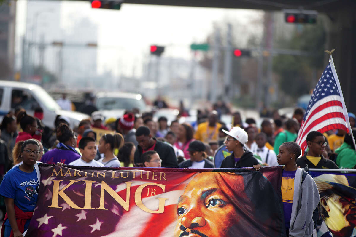 Thousands gathered along Texas Avenue next to Minute Maid Park during the Black Heritage Society's 36th Annual Original Martin Luther King Jr. Parade downtown Monday, Jan. 20, 2014, in Houston.