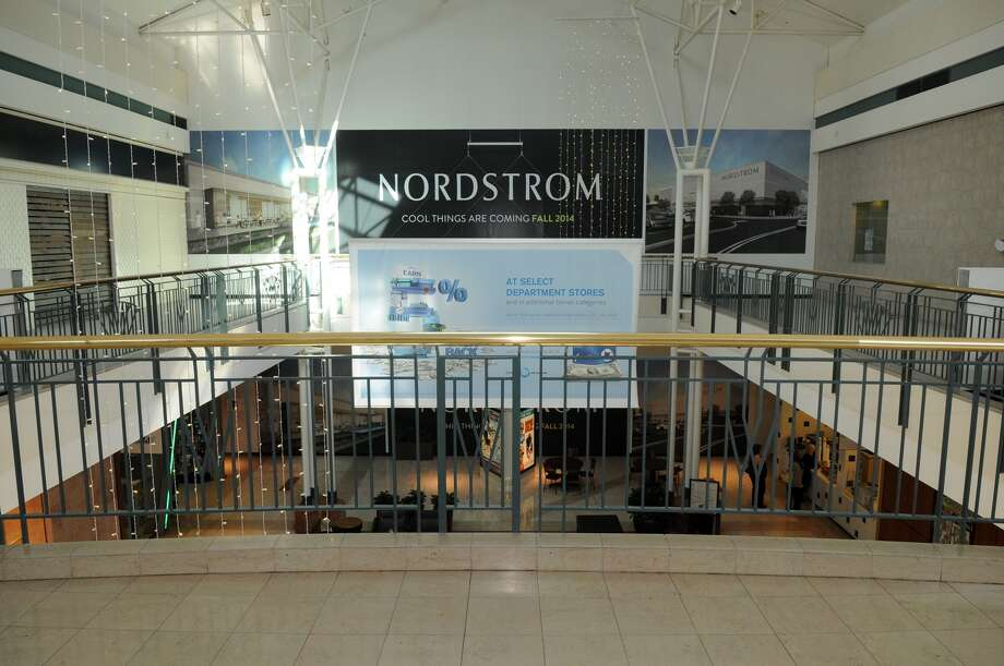 Work continues on the Nordstrom store at The Woodlands Mall. Barricades hide the progress being made from shoppers. A new wing of retail space also will be located next to Nordstrom, containing four-to-six shops. Nordstrom is to open Sept. 5. Photo: Jerry Baker, Freelance