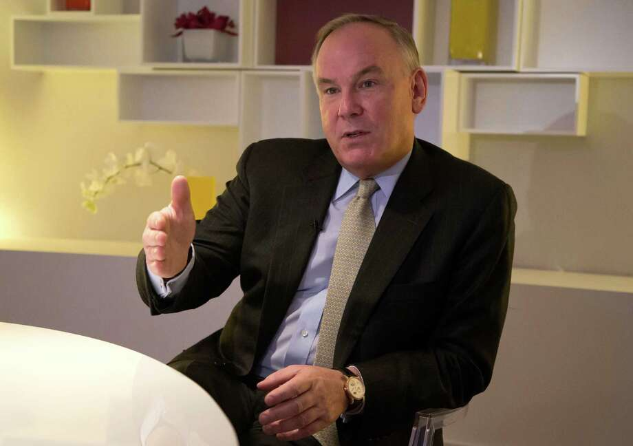CEO of PricewaterhouseCooper International,  Dennis M. Nally, speaks during an interview with The  Associated Press  in Davos, Switzerland, Tuesday, Jan. 21, 2014. The world's financial and political elite will head this week to the Swiss Alps for the 2014 gathering of the World Economic Forum at the Swiss ski resort of Davos. (AP Photo/Michel Euler) Photo: Michel Euler, Associated Press / Associated Press contributed