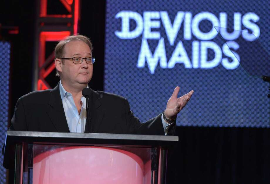 "FILE - In a Thursday, Jan. 9, 2014 file photo, creator and executive producer Marc Cherry speaks on stage at the Lifetime/A&E Winter Press Tour, in Pasadena, Calif. Cherry  and Damon Lindelof, creators of two of the most indelible dramas on network television last decade, ""Lost"" and ""Desperate Housewives,"" are making programs for cable networks now. Once often content to air reruns, cable networks are busy establishing themselves as creators. (Photo by John Shearer/Invision for A&E Networks/AP Images, File) ORG XMIT: NY113 Photo: John Shearer / Invision"