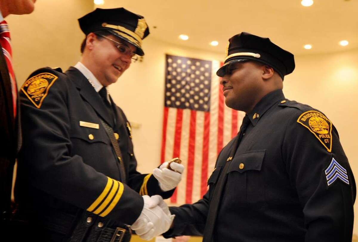 Sgt. Jeffery Grice is sworn in during Bridgeport's Sergeant Promotional Ceremony Wednesday Feb. 3, 2010 at City Hall.