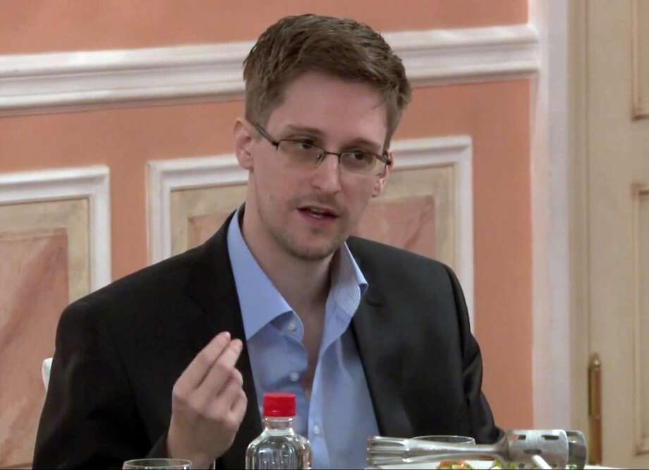 In this image from a video released by WikiLeaks, former NSA analyst Edward Snowden speaks in Moscow. Photo: Uncredited, Associated Press