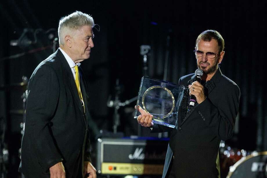 "Director David Lynch, left, presents musician Ringo Starr with the ""Lifetime of Peace & Love Award"" on stage during the David Lynch Foundation Honors Ringo Star ""A Lifetime of Peace & Love"" event held at the El Rey Theatre on Monday, Jan. 20, 2014, in Los Angeles. (Photo by Paul A. Hebert/Invision/AP) ORG XMIT: CAPH107 Photo: Paul A. Hebert / Invision"