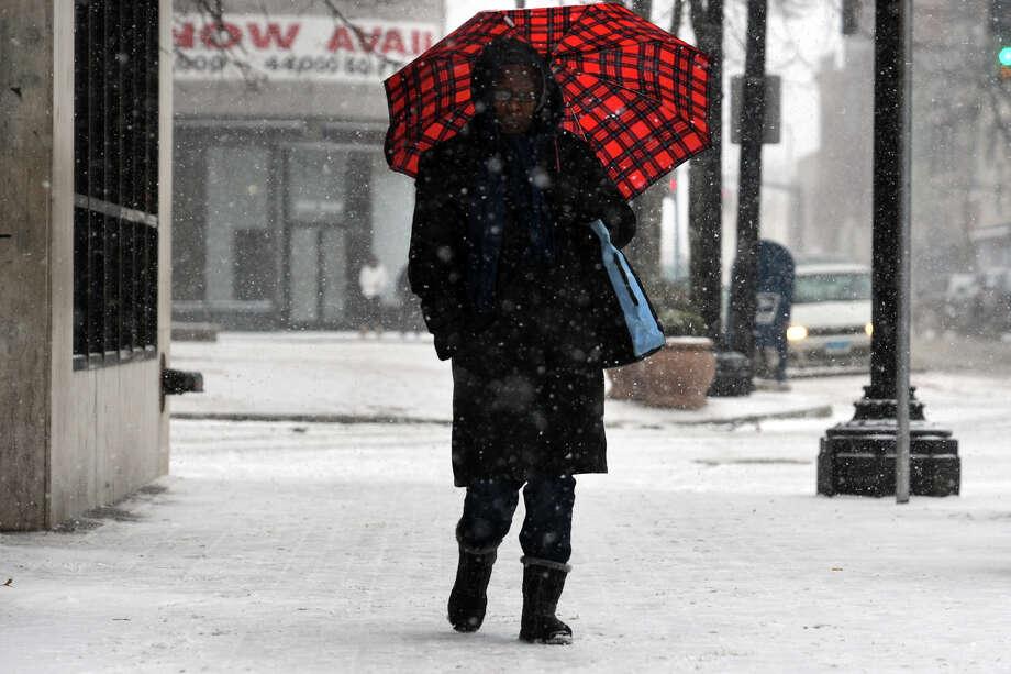 Maggie LeFakane, of Bridgeport, walks in the snow along Main Street in downtown Bridgeport, Conn. Jan. 21, 2014. Photo: Ned Gerard / Connecticut Post