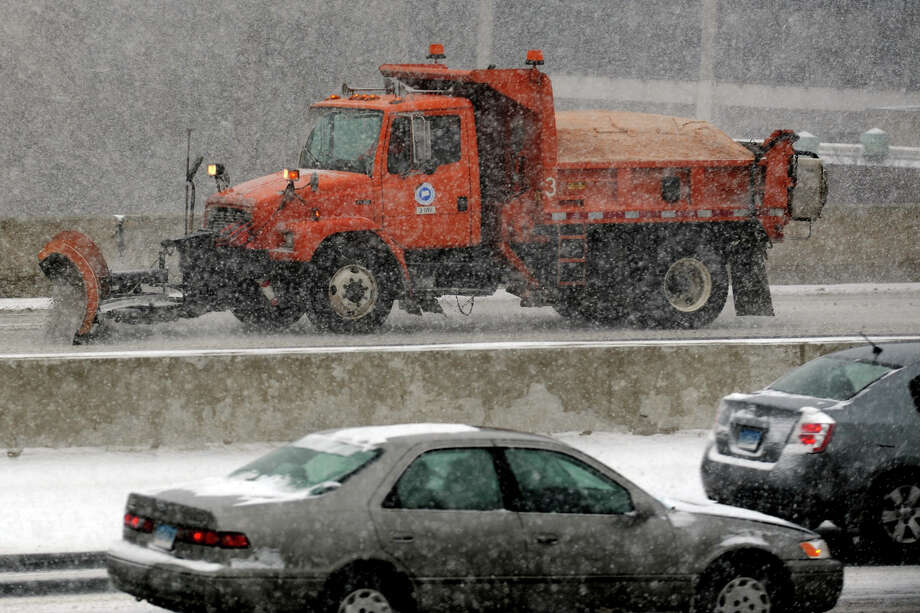 A state DOT truck plows snow along I-95 in Bridgeport, Conn. Jan. 21, 2014. Photo: Ned Gerard / Connecticut Post