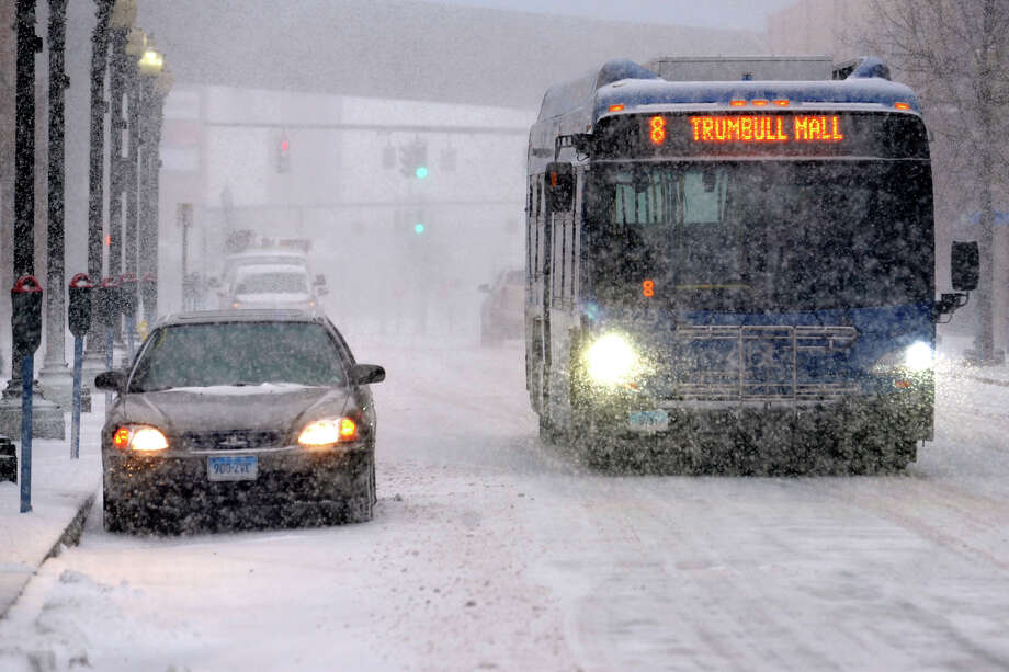 A GBT bus drives in the snow in Bridgeport, Conn. Jan. 21, 2014. Photo: Ned Gerard / Connecticut Post