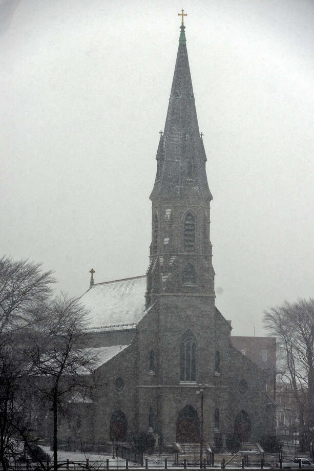 Snow falls on St. Augustine Cathedral, in Bridgeport, Conn. Jan. 21, 2014. Photo: Ned Gerard / Connecticut Post