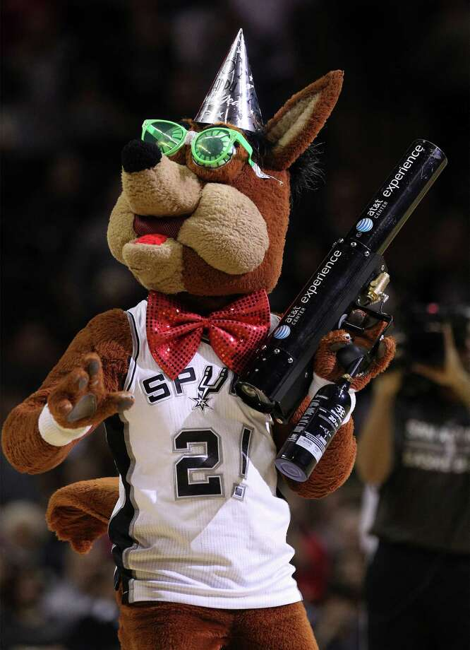 The Spurs Coyote revels in New Year's Eve garb during the Spurs game against the Brooklyn Nets at the AT&T Center on Tuesday, Dec. 31, 2013. Photo: Kin Man Hui, San Antonio Express-News / ©2013 San Antonio Express-News